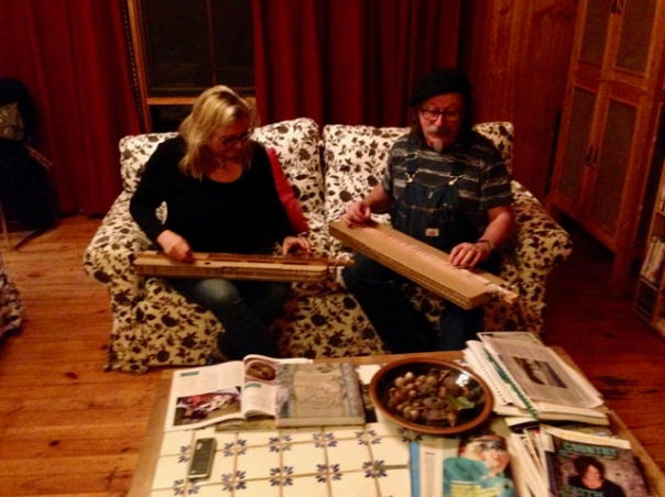 Carla and Adrian playing cardboard dulcimers built by Richard Troughear using Ikea packing materials.